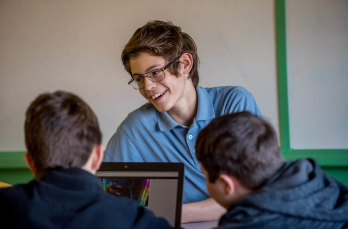 Smiling male student in class