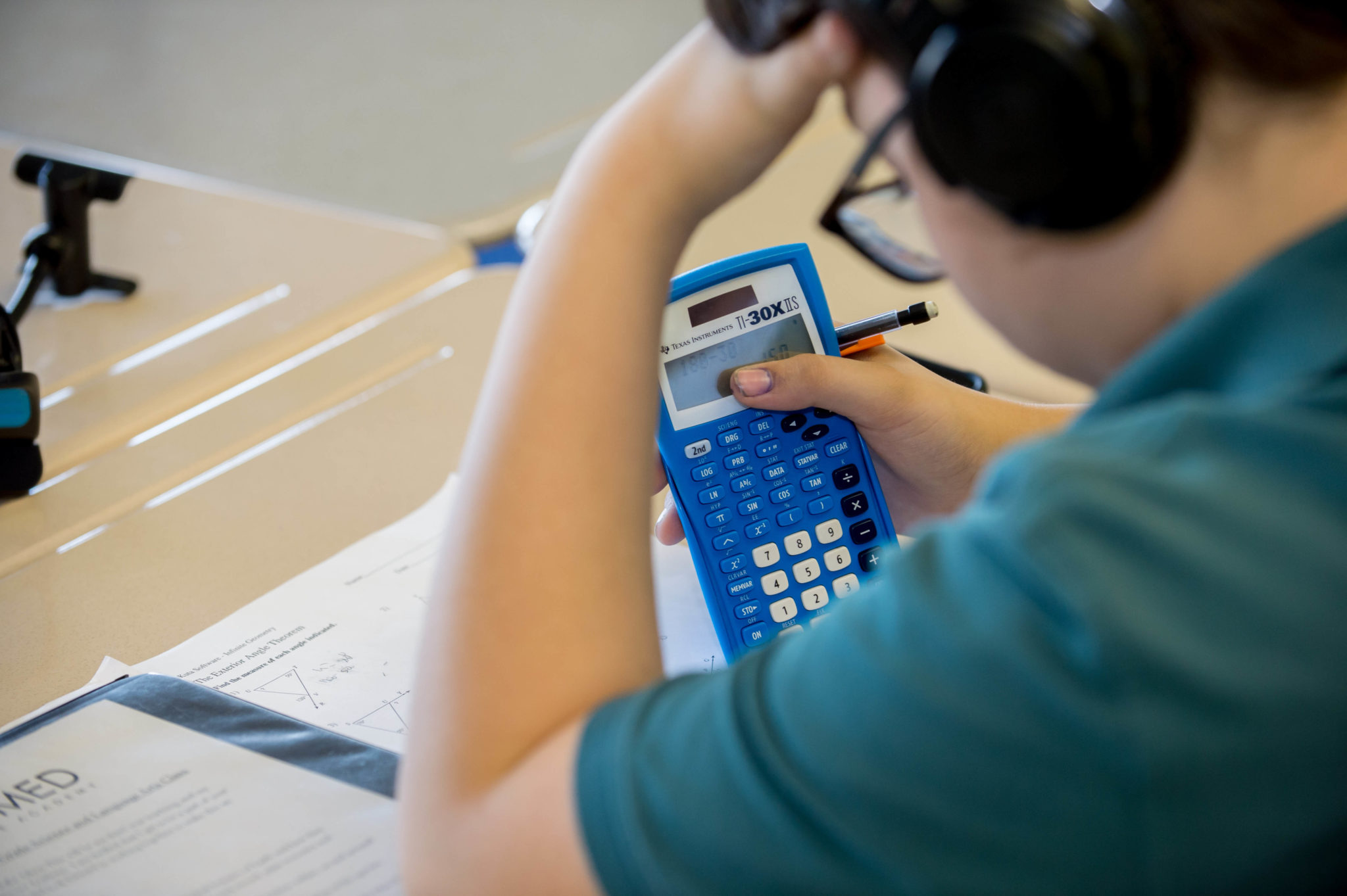 Male student using calculator